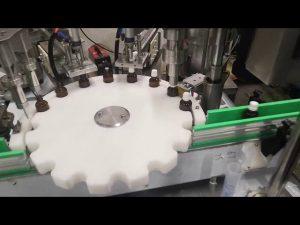 pequena máquina de engarrafamento de líquidos